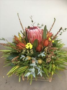 Table centre, by bloomin natives! Table Centers, Floral Arrangements, Nativity, Centre, Floral Wreath, Tropical, Gardening, Wreaths, Elegant