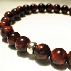 A personal favorite from my Etsy shop https://www.etsy.com/listing/277494010/tigers-eye-bracelet-red-tigers-eye