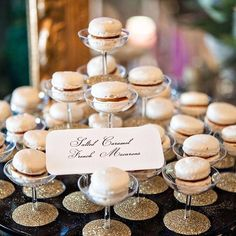 Elevate your #dessert table. Macs look best in tiers (and in champagne glasses)! Photo by @juliannajphotography #Tips #Catering #Champagne #LadyYum