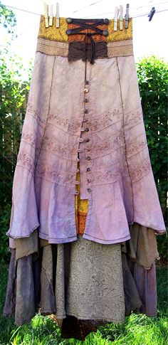 Sneak Peek of TERRA...still drying on the line ~ AuraGaia ~ tattered poorgirl earthy organic skirt...bustleback, underskirt & overskirt, faux corset front; ruffles, layers, upcycled, overdyed, silk, homespun, linen, silk, cotton, lace, paisley, taupe, marigold, rust, brass buttons, tan, brown,
