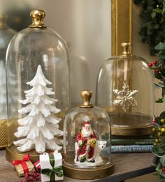 white artificial Christmas tree and Santa Claus figure under glass