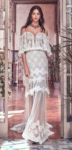 Galia Lahav 2018 romantic Victorian tea gown - A romantic Victorian tea gown made of French fish net lace and French Chantilly lace, layered in multiple layers of various lace trims. The gown has a sheer corset with a low plunging neckline and the shoulders have a French lace cape feature. The back has a peek-a-boo sheer V panel, creating a sensual silhouette.