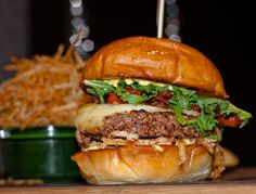 M.K. Burger with Truffle Gouda, Crispy Shallots, Arugula, Garlic Aoli and Brandt Beef Bacon