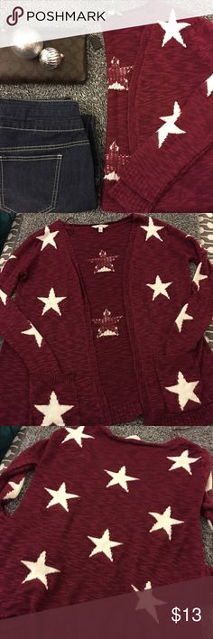 Adorable Maroon, star patterned, long sweater Cute winter piece with 2 front pockets. Looks loved but I'm thinking that's how it's supposed to look-that's how I got it. Great for layering and keeping warm. Good shape with minimal signs of wear. Smoke free. About 31 inches from shoulder to hem. Long sleeve. Slightly oversized fit/look with an open front. Bust is about 20 inches flat. Hips are roughly 24. Can fit most depending how you like it to fit! Have questions? Feel free to ask! Offers…