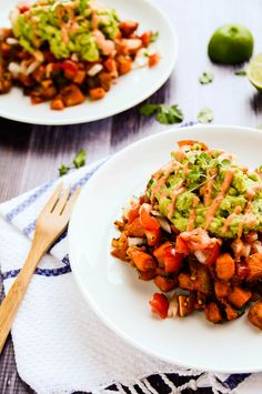 Healthy Southwest Sweet Potato Breakfast Hash topped with fresh pico de gallo, poblano-spiced guacamole + a drizzle of chipotle cream.