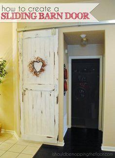 a stepbystep tutorial on how to create a sliding barn door
