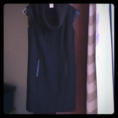 NWT wool cowl neck dress w faux leather detail Gorgeous black Ann Taylor wool sheath dress with chunky sweater knit cowl neckband faux leather cap sleeves and pocket trim. Never worn! Sheath: 86% virgin wool, 9% nylon, 5% Lycra/spandex. Fully lined. Turtleneck: 52% acrylic, 48% wool Ann Taylor Dresses