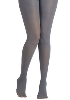 Layer It On Tights in Light Grey. Enjoying your favorite warm-weather clothes year 'round is a cinch now that you've welcomed these pale grey tights into your wardrobe! #grey #modcloth
