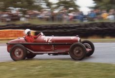 In 1929, Enzo Ferrari left Alfa Romeo's employment to start his own racing stable (scuderia in Italian). Scuderia Ferrari did not race cars with the Ferrari name, though the Alfas they used on the track did sport the prancing horse. Race cars came to the scuderia from Alfa for tuning for almost a decade, and the Ferrari shop in Modena built its first car, the Alfa Romeo 158 Grand Prix racer, in 1937.