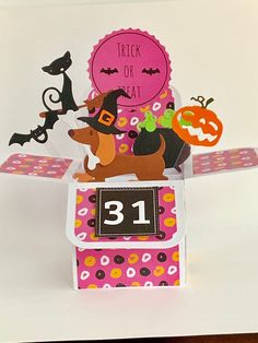 Excited to share this item from my #etsy shop: Halloween Dachshund/Sausage Dog pop up card, 3D card, exploding card, handmade card, cauldron, bats, pumpkin, cat card #halloween #childshalloween #broomstickcard #batscard #pumpkincard #cauldroncard Halloween Pop Up Cards, Halloween Themes, Pumpkin Cards, Cat Cards, Cellophane Bags, Cauldron, Bats, Dachshund, Sausage