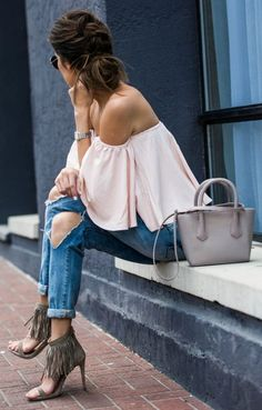 love this romantic off the shoulder blouse paired with the destroyed denim