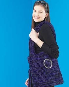 An easy crochet pattern is this tote bag for beginners. Bernat Softee Chunky yarn is used for a nice solid bag. The metal belt buckle is a great closure that you just have to sew on.