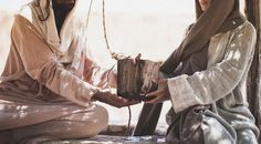 It was high noon. Jesus, foot-weary from His long journey, was resting beside Jacob's well. His disciples had gone into the city of Sychar to buy bread. A woman came out of the city to draw w...