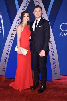 Scotty McCreery (R) and Gabi Dugal (L) attend the 51st annual CMA Awards at the Bridgestone Arena on November 8, 2017 in Nashville, Tennessee. - 4 of 273