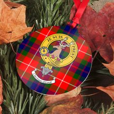 Aluminium ornament with printed clan crest and tartan - several shapes available. Ornament is printed with clan crest and tartan on one side and tartan on reverse. Choose from Bauble, Tree, Star, Heart, and Gingerbread Man. Printed in Edinburgh, Scotland. Pictured Fraser of Lovat - Fraser