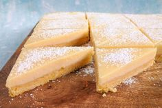 These shortbread triangles may be simple to make but are just bursting with strong lemony flavour - both in the biscuity base and in the soft, condensed milk topping. Baking Recipes, Dessert Recipes, Desserts, Cake Recipes, Custard Slice, Sweet Potato Patties, Light Cakes, Patties Recipe, Mince Pies