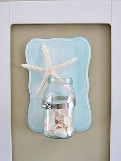 Create a breezy wall sconce with a mason jar and souvenirs from the beach #masonjars