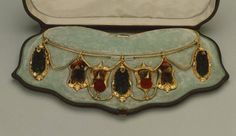Gold necklace with seven pendants of emerald green and scarlet humming-birds' heads, the feathers attached to a gold backing, made by Harry Emanuel, London, 1865. Jewelry Case, Jewelry Necklaces, Gold Necklace, Museum Shop, Leather Box, Detailed Image, British Museum, Emerald Green, Hummingbird