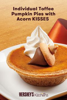 Hello fall, hello Toffee Pumpkin Pies with Acorn KISSES Chocolate! Welcome the fall with your family and these seasonal treats. Topped with our HERSHEY'S KISSES Acorn Treats, these mini pumpkin pies are the ultimate Thanksgiving treat or dinner party dessert.