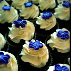 Chocolate, Chocolate Chip Cupcake with Butter Cream and Fondant Flower. MLopezCatering@yahoo.com