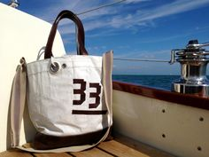 sail bag made of recycled sailcloth combined with genuine leather by Rough Element More sail bags at www. etsy.com