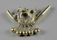 A child's silver rattle, 18th Century continental. In the form of a mermaid blowing a trumpet, with whistle and five bells.