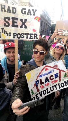 Darren Criss at the Women's March in Los Angeles>> his case has jewls.....