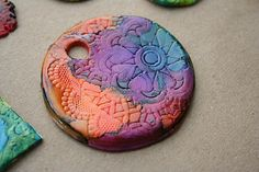 """polymer clay embossed pendant tiles - use paper doilies to emboss and alcohol inks to """"stain"""" them. Stunning!!"""