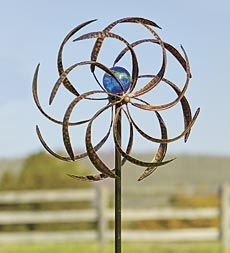 metal-wisp-wind-spinner-with-glowing-glass-orb from Plow & Hearth