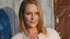 Uma Thurman keeps it chic in white at Givenchy NYFW show in New York City.