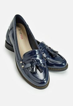 Navy blue faux patent leather tasseled loafers. Slip into these casual cool flats that don't need any lacing. The Bronnie is a penny loafer that features tassel detailing and a low block heel, a style that's menswear inspired with a touch of feminine appeal. Exposed zipper teeth. Patent faux leather....