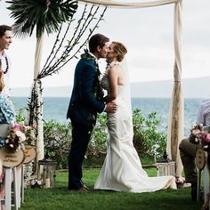 YOU MAY KISS YOUR BRIDE - Remembering this sweet moment with Dana & Kurt!  Love this assymetrical canopy decor by @dellablesfloraldesign