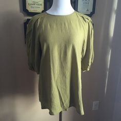 Calypso St Barth Elisa Top - NWT New with tags. There is an incredibly small pen mark on the top that I only noticed when I went to list it. Other than that, in flawless condition. Beautiful green color, super flattering. Calypso St. Barth Tops Blouses