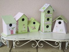 bird houses and bird cages might not be difficult to borrow and use (even paint old ones)