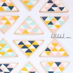 geometric cookies- Decorated Triangle cookie. http://www.annclarkcookiecutters.com/product/triangle-cookie-cutter