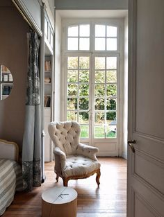 bedroom w/french doors (living with French antiques - a passion - Sharon Santoni)