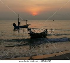 sun setting on fishing boats in the Thai Gulf