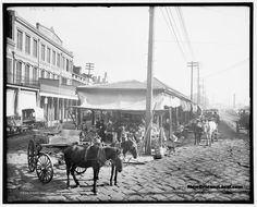 A view of the French Market in New Orleans. Vendors selling produce and their customers are seen. Louisiana History, New Orleans Louisiana, Old Photos, Vintage Photos, New Orleans History, Between Two Worlds, Dere, Crescent City, Down South