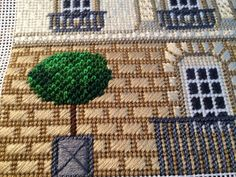 Wonderful stitches  in this needlepoint building detail