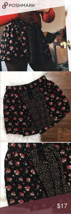 {Forever 21} Black and Floral Mini Skirt Pretty black and floral Flowy Mini Skirt in great used condition! Size Small Forever 21 Skirts Mini