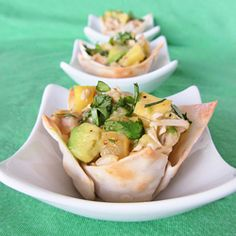 Tropical Chicken Cups - a fun appetizer of wonton cups filled with chicken, pineapple, avocado, coconut & lime