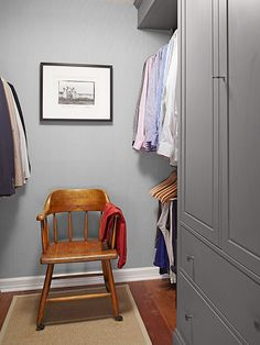 Mix built-ins like this floor-to-ceiling armoire with stacked hanging rods for maximum efficiency in master closets.