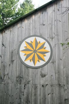 barn quilts on side of garage, house, or shed? Could be made on a separate piece of wood like this one...
