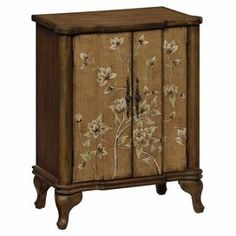 "2-door chest with floral-print door fronts and 1 shelf.   Product: ChestConstruction Material: Poplar wood and engineered wood Color: TanFeatures:  Two doorsOne shelfDimensions: 27"" H x 26.5"" W x 12"" D"
