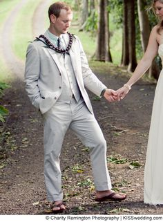 Semi formal men's beach wedding attire. A linen suit with a matching vest and sandals. Stylish!