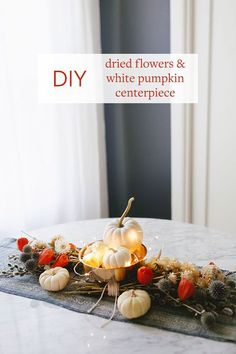 Click thru to learn how I used dried flowers, mini twinkly lights, and white pumpkins for a super simple, eye-catching centerpiece for fall or Thanksgiving entertaining. Get the full DIY tutorial on Jojotastic.com just in time for the holidays and all tho