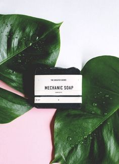 mechanic soap with green leaves, pink and white flat lay