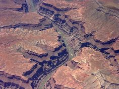 Aerial view of the Grand Canyon, Northwest Arizona. Photo taken out commercial jet window. Colorado River in this photo is the thin, green ribbon in the bottom of the Grand Canyon. The Colorado River runs through this scenic canyon and along the western edge of Arizona. credit: fireflyforest.net