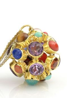 We're loving this fun pendant! It will easily add personality to any f your outfits. Estate Multi-gemstone Multi-shape 18K 2 Tone Gold Pendant Length 17Item #487-115317 Gem Shopping Network