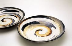 Jane Sawyer - studio potter. She uses slip when it's freshly thrown to create the textured surface. I guess she used colored slip as well. Nice idea.